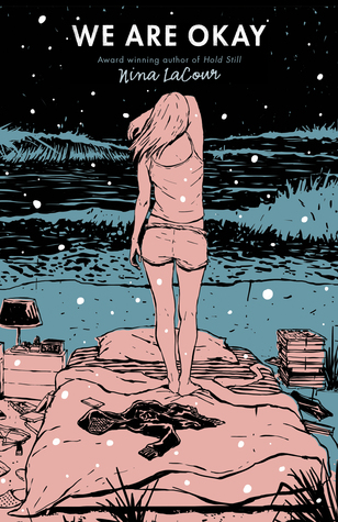 Cover of We Are Okay by Nina Lacour. Illustration of a girl standing on a bed, both coloured pink, who looks into a blue lake whilst snow falls. width=