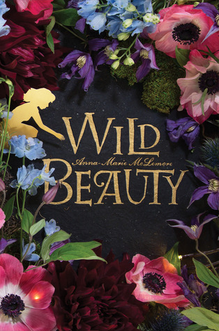 Cover of Wild Beauty by Anna-Marie McLemore. The title in gold, fairytale-esque font in the centre with lush flowers all around, and a gold outline of a girl reaching out to the title.