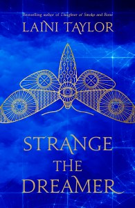 Cover of 'Strange the Dreamer' by Laini Taylor. Illustration of an intricate gold dragonfly on a background of blue clouds.