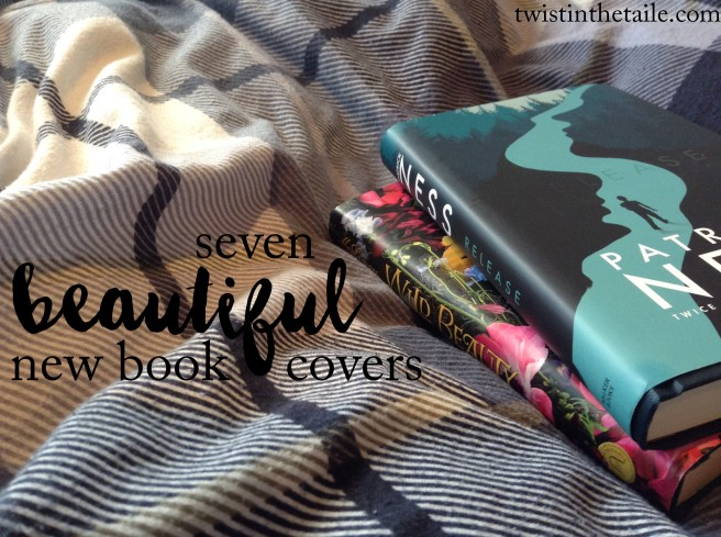 Two hardback books, Release and Wild Beauty, on a stripey blue blanket, with the words '7 beautiful new book covers'