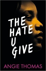 Cover of 'The Hate U Give' by Angie Thomas. Photo of a black girl looking out on a black background, with the title written in white capitals.
