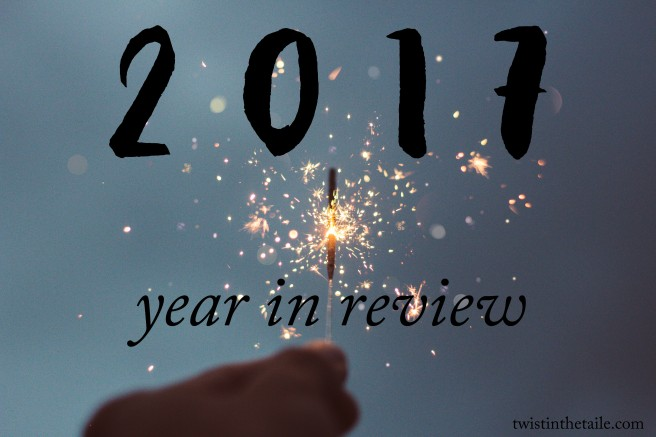 Photo of a hand holding a lit sparkler, with the words '2017 year in review'