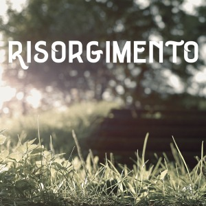 Sunlight streaming over grass with a blurry tree in the background. The word 'Risorgimento' in a blocky font.