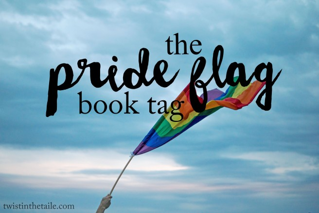 A hand holding up a rainbow pride flag over a clouded sky, with the words 'the pride flag book tag'.