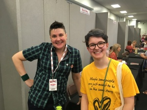 Eve and Non Pratt. Eve wears a yellow t shirt that reads 'maybe some people are just meant to be in the same story'.