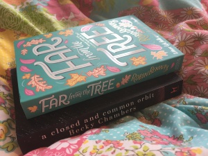 The books Far From the Tree and A Closed and Common Orbit. The cover of Far From the Tree has illustrations of falling leaves.