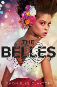 Cover of The Belles. A glamorous brown-skinned person with flowers in their hair looks back at the camera. The subtitle reads 'the revolution is here' and the title text is disintegrating.