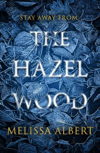 Cover of The Hazel Wood. Illustrations of blue leaves and the text 'Stay away from the hazel wood'