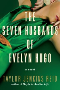 Cover of The Seven Husbands of Evelyn Hugo. A person wearing red lipstick, red nailpolish and a green shirt with a low neckline poses. Her eyes and the rest of her face cannot be seen.